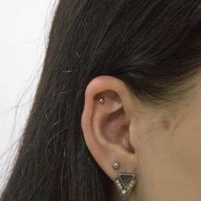 Прокол уха