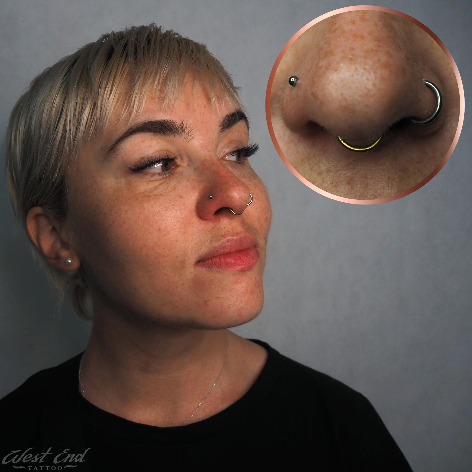 Пирсинг носа у женщины