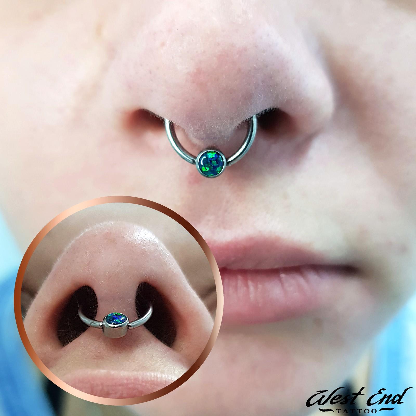 Пирсинг септум хряща носа