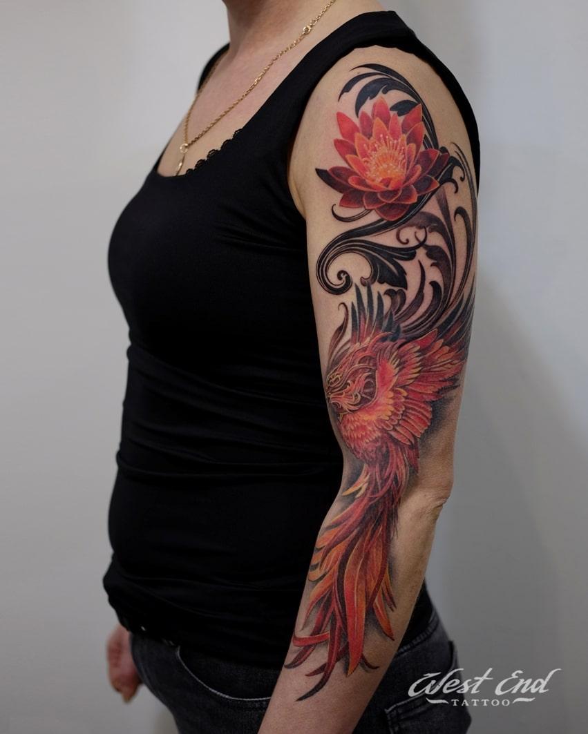 Тату композиция с лотосом и фениксом на руке