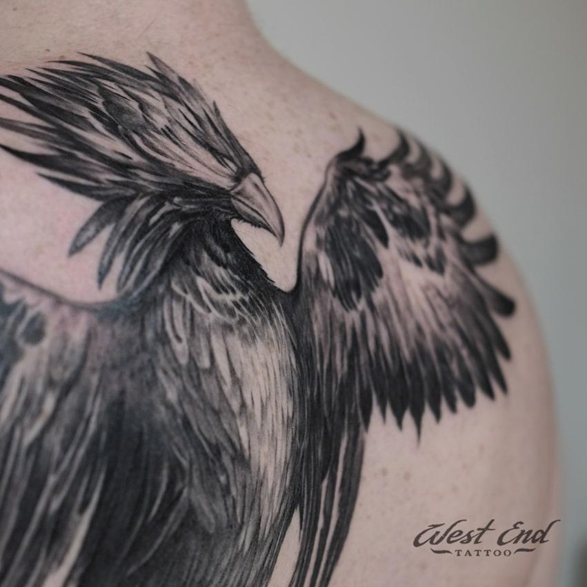 Тату птица феникс на спине